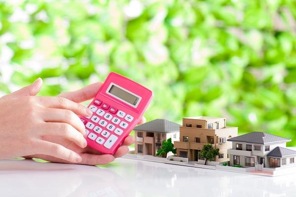 住宅販売 電卓 緑の背景