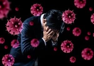 ウイルスに感染したビジネスマン